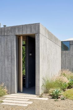 Mork-Ulnes Architects' concrete retreat in California is equipped for climate change   Feeling relaxed inside a sturdy piece of architecture begins with feeling safe – even when, as in this case, it is cantilevered over a ravine – which is why the pair decided to build this new addition to a young family's holiday home entirely in concrete. And the trio of concrete cocoons soon had occasion to prove their protective credentials #concrete #concretearchitecture