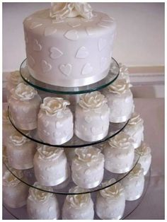 Budget friendly cake - combine one small top tier with petit fours on pedestals!