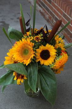 Sunflower arrangement with local cattails and sunflowers for a Greenlife Grocery in Asheville catering event