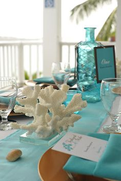 I'm really leaning toward coral centerpieces - even planned on having tablecloths this color! #DBBridalStyle