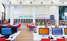 For the Kids: The children's reading room at the Washington Heights Branch of the New York Public Library encompasses the entirety of the branch's second floor. The open space features a loop of shelving and casework that encircles the reading areas, provides seating at each window, and features self-checkout stations. Couches are paired with window seats to create intimate spaces within the room. Renovation; Andrew Berman Architect; Photo: Naho Kubota.