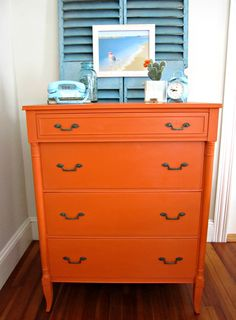 Stockist, Sea Rose Cottage of Bristol, RI brightens up a space with Barcelona Orange Chalk Paint® decorative paint by Annie Sloan on a sleek dresser!