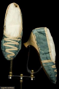 """Lady's blue silk satin shoes, worn 1803, style 1780-90s. Paper note included, written in script, """"Wedding shoes of Hannah Hodgkins who married Nathaniel Wade May 3rd 1803"""", style indicates decade earlier date, robin's egg blue satin uppers trimmed w/ white silk ribbon, white leather narrow """"Italian"""" heels. Augusta Auctions"""