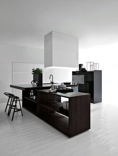 clean and modern kitchen, love the idea of covering the hood and making it into a conversational piece in the kitchen.Materials are also very nice:)
