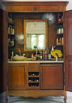 """KITCHEN ARMOIRE - Got a flatscreen now? Save that old armoire and turn it into a bar. Gives new meaning to """"entertainment center. Diy Home Bar, Diy Bar, Bars For Home, Armoire Bar, Kitchen Armoire, Cupboard, Vintage Armoire, Old Entertainment Centers, Armoire Makeover"""