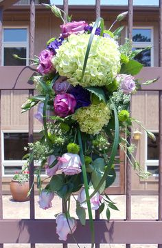 Gate Arrangement of roses, hyrdrangea, lisianthus, mini green hydrangea, kermits, queen anne's lace
