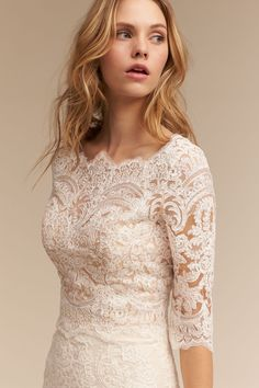 Brides Capri Top from @BHLDN Dazzle in this lace top, worn over a skirt or as a cover up to a sleek gown. We've fallen for the scalloped detailing at the bateau neckline and picture-perfect row of back buttons. We love how it perfectly transforms the Leigh Gown into a lace-sleeved beauty.