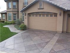 I love this driveway pattern! Resurfaced concrete driveways are a great alternative to replacing existing driveways, and can cut costs dramatically. Richardson's Concrete Effects Carmichael, CA Cement Driveway, Stamped Concrete Driveway, Driveway Design, Concrete Driveways, Concrete Patio, Driveway Ideas, Walkways, Circle Driveway, Asphalt Driveway