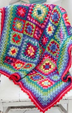 Free Crochet pattern for blanket~ make 4 big squares, 33 small squares.  Very good, detailed pattern from start to finish.  #crochet #granny_square #blanket #afghan