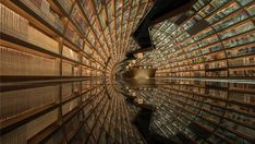 Floor to ceiling arched bookshelves and a black mirrored floor create a tunnel of books inside this store. Yangzhou, Cabinet D Architecture, Library Architecture, Tianjin, Chengdu, Zaha Hadid, Wuhan, Shanghai, Brick Studio