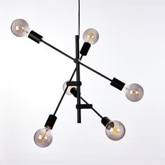 Cross taklampe over kjøkkenbenken. Hanging Canvas, Work Surface, Modern Kitchen Design, Sorting, Gallery Wall, New Homes, Chandelier, Ceiling Lights, Living Room