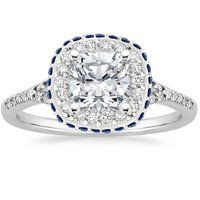 This glamorous halo setting features an additional row of diamonds set around the exterior edge of the halo and diamonds on the gallery and on the slight split-shank band, creating an effect of magical shimmer.