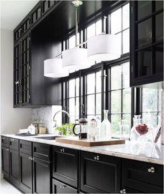 Black cabinets, marble/granite counter.