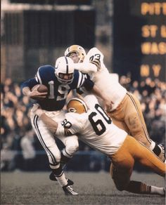 Johnny Unitas under siege from Green Bay.