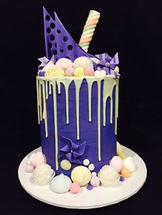 Chocolate and caramel layered mud cake coated in Purple buttercream with white chocolate drip. #allsortscakessydney