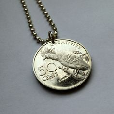 1977 Guyana 50 cents coin pendant necklace jewelry Guyanese National Bird Hoatzin Creativity Amazon parrot stinkbird Proof coin No.000745 by acnyCOINJEWELRY on Etsy