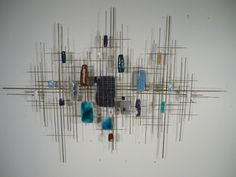 Enamel and metal wall sculpture