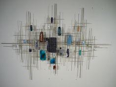 Enamel and metal wall sculpture