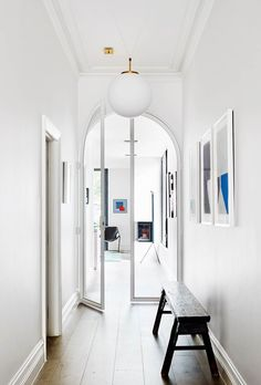 14 luxury hallway design ideas Kathryn Robson and Chris Rak's Melbourne home is an exercise in restraint and pure good taste. Artworks by Chris Connell in the hallway, which looks through to a Caspar Fairhall painting. French Interior Design, Interior Design Studio, Entry Hallway, White Hallway, Hallway Art, Melbourne House, Hallway Designs, Modern Mansion, Hall Design