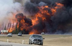 Devastating: A wildfire burns south of Fort McMurray, Alberta, near Highway 63 on Saturday