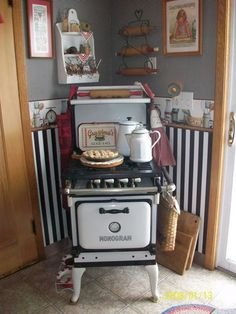 Sheryl Almaguer bought this vintage stove at a yard sale for just $50.  Yes, $50.   It is small, but that is part of the charm.  You can imagine it in an aparement or flat in days gone by.  That black and white also is elegant.   The moral of the story is never underestimate a yard sale!