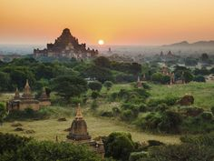 Bagan Temples Myanmar outdoor sky grass building historic site archaeological site landmark Ruins ancient history hill landscape rural area temple place of worship screenshot unesco world heritage site savanna pagoda terrain hillside distance