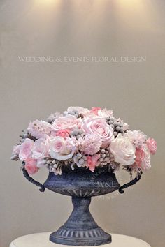 Stunning centerpiece made with Sweet Avalanche by Meijer Roses in design of Wedding and Events Floral Design