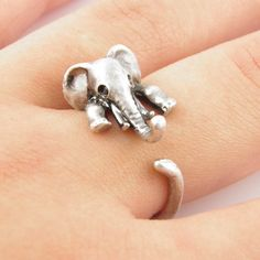 This silver elephant ring is slightly adjustable with a gentle squeeze. It fits a size 5-9. He is sweet with rhinestone eyes, curled trunk and big floppy ears as this little guy wraps around your fing