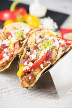 Chicken Fajita Tacos with Cotija Cheese - These Chicken Fajita Tacos are light, refreshing and healthy! You will love the bright, crisp flavor with just a touch of lime zest! Amazingly good and low fat too.