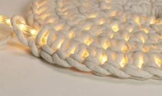 Crochet around rope light to make an outdoor floor mat. this is one of the coolest things I've ever seen. @Crystal West Lucas  SO COOL