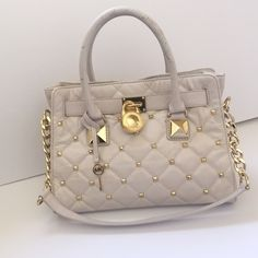 """Michael Kors Studded Hamilton Gold tone studded quilted cream Hamilton satchel by MICHAEL Michael Kors with double handles and shoulder strap. Interior with zippered pocket and 2 multi function slip pockets.* Some wear visible in double handles and top of bag as well as on bottom edges. Width 12.5"""", Height 9"""", Base 4"""" Handle Drop 5"""", Strap Drop 10"""". Michael Kors Bags Satchels"""