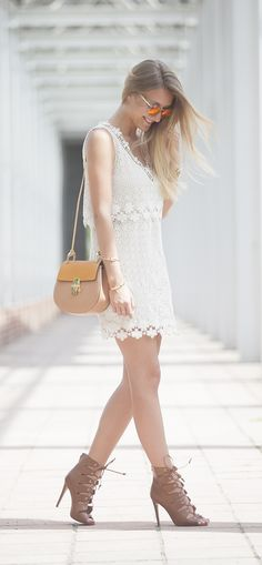 Breezy white lace dress for the perfect Summer afternoon look.