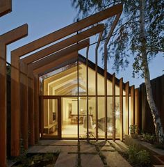 """Cross Stitch House by FMD Architects. FMD Architects used slender lengths of timber to """"stitch"""" together this narrow Melbourne house and its new garden extension. Architecture Design, Architecture Courtyard, Timber Architecture, Residential Architecture, Amazing Architecture, Natural Architecture, Timber Buildings, Landscape Architecture, House Landscape"""