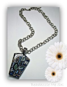 Black Garden Carved Pendant, polymer clay jewelry.