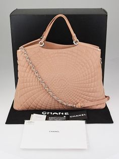The Chanel Pink Quilted Iridescent Calfskin Leather Sea Hit Large Tote Bag from Spring 2012 features an east/west tote style, with iridescent calfskin leather that creates a unique shiny effect in the classic Chanel diamond quilting pattern. This particular bag comes in a stunning pink (color code: 81446).  You can carry this stunning bag with two leather top handles or with a leather/chain entwined shoulder strap. With ample room to carry your essentials and the classic CC logo on the ...