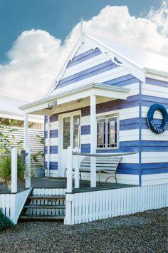 Cute as a button! Love this blue and white little beach shack.