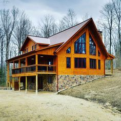 """""""Rome wasn't built in a day, but this cottage was!"""" - Host of """"My Retreat"""" See the construction of this gorgeous Timber Block home from the foundation to what it looks like today. #TimberBlock #Cottage #cottagelife #cottageliving #loghome #logcabinhome #homebuilders #woodhome #panelized #buildgreen #sustainability"""
