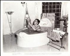 0 bath time - Olivia de Havilland in the bathtub