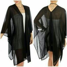Black Woven Kimono Absolutely stunning scarf shawl kimono features a hi low design. Can be used as a cover up for any outfit or dress, bathing suit, or as a scarf. Very versatile and elegant piece. Sheer. Size: 50 x 28 Flat inch Flat Fabric: 100% Polyester Swim Coverups