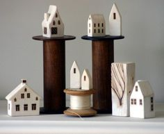Miniature wood houses  love these.  I would love to put a village on my mantle year around with lights in the houses.  Does anyone know where I could get a village that isn't a Christmas theme?