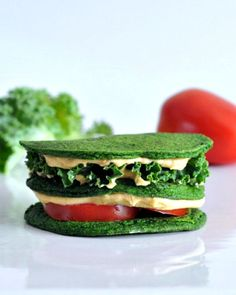 Spinach Pancake sandwich with hummus, kale, and tomato