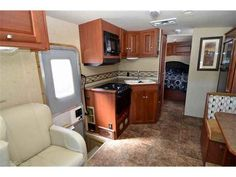 2013 Used Winnebago Vista 26HE 26HE Class A in California CA.Recreational Vehicle, rv, Winnebago Vista 26HE 26HE, 2013 Winnebago Vista 26HE Slide-Out Class A. This coach is built on a Ford chassis and powered by a Ford Triton 6.8L V10 Engine with only 4,066 miles! Equipment includes: Side-Hinged Baggage Doors, Pass Through Storage, Hydraulic Leveling Jacks, Auto Patio Awning, Ducted Roof A/C, Rear View Camera, Leather Cockpit Seats, CD Player, and LCD TV in Bedroom, LCD TV in Cockpit…