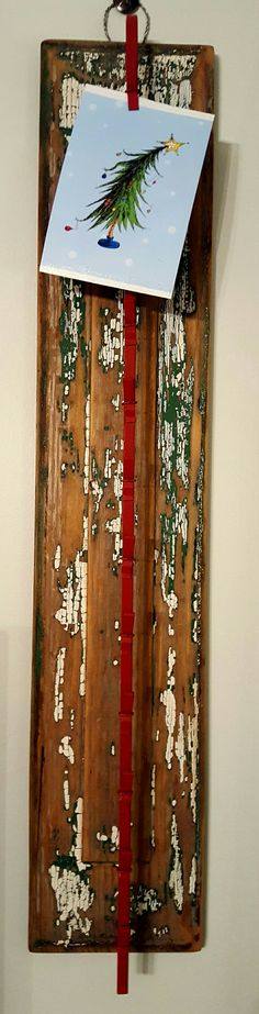 Christmas card display, old piece of wood from screen door, metal chip holder, a little twist of wire.
