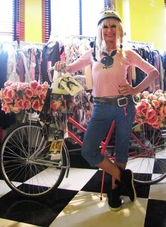 Betsey and the team are ready to paint the town pink on their way to show off her Tour de Fashion hot pink, floral bike!