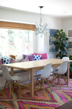 A colorful kilim rug makes a statement in this dining room