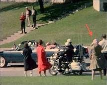 """Unexplained mysteries of the JFK assassination - Whatever happened to the mysterious """"Babushka Lady,"""" who was seen in the Zapruder film of the assassination? Zapruder's film depicts a woman wearing a head scarf who in turn is filming the JFK motorcade at the moment of the assassination. Given that the Babushka Lady is very close to the motorcade, her film would offer invaluable evidence if it could be located today."""