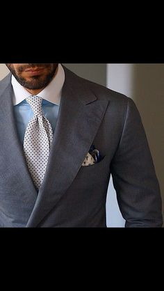 Great use of a grey suit to add color and pattern with the shirt, tie, and pocket square