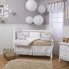 Grey/champagne damask crib bedding.  This will be her new bedding.
