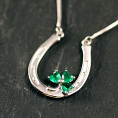 """Our Shamrock Horseshoe Necklace says you're lucky to be Irish but even luckier to have her. Both the horseshoe and shamrock are considered to be very lucky. The shamrock, also the symbol of Ireland can be traced back to the Irish word seamróg or seamair óg, meaning """"little clover"""". The tradition of wearing Shamrock on Saint Patrick's Day can be traced back to the early 1700s. Whatever your reason for getting this brilliant Lucky Horseshoe Shamrock necklace will certainly brighten your day!"""