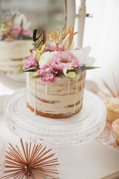 It's a girl gender reveal cake. Pink and white naked cake with flowers. @honeyandbetts